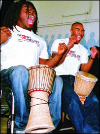 Colin Jackson (right) with Ade Adepitan at the Kids Co. project in London