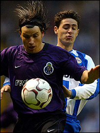 FC Porto's Nuno Valente fights for the ball with Deportivo La Coruna's Victor