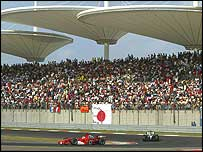 Rubens Barrichello of Ferrari leads McLaren's Kimi Raikkonen in the Chinese Grand Prix