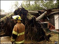 A firefighter inspects hurricane damage