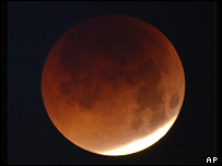 The Moon takes on a red tinge, AP