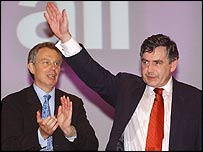Tony Blair applauds as Gordon Brown acknowledges conference support