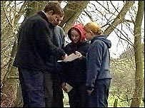 students reading a map on an orienteering course