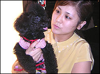 Masumi Takano, with her dog Poo-chan