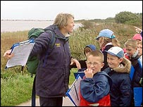 instructor and primary school pupils on field trip