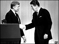 Reagan shakes hands with Carter