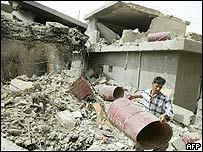 An Iraqi man clears the rubble of a house that was destroyed during the fighting