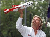 Sir Richard Branson and a model of his proposed Virgin space ship