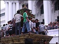 Crowds pull the Kumari's chariot through Kathmandu