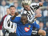 Lomana LuaLua (left) playing for Portsmouth against Newcastle