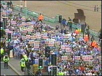 Fans march along Brighton seafront