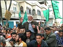 Jubilant Palestinians carry freed Hamas co-founder Sheikh Mohammed Taha in Bureij refugee camp, Gaza