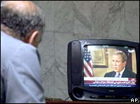 Egyptian watches the interview with Mr Bush