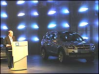 The chairman of GM Europe, Fritz Henderson, launches a Chevrolet at the Paris Motor Show 2004.