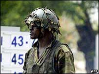 A Nigerian soldier stands guard on an oil installation