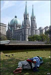 A homeless man sleeps rough at Sao Paulo cathedral