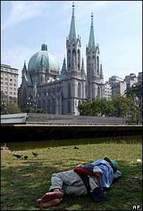 A homeless man sleeps rough at Sao Paulo cathedral