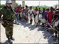 A UN soldier guards a relief centre in Gonaives, Haiti