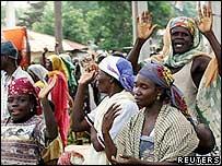 Nigerian Muslim women wait beside their belongings to be evacuated from Yelwa (Reuters)