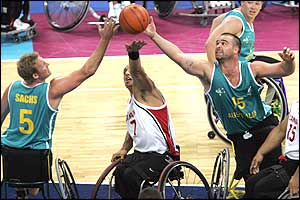 Canada's Richard Peter (centre) fights for the ball with Australia's Troy Sachs (left) and Brad Ness
