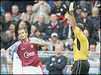 Aston Villa's Lee Hendrie is booked for celebrating