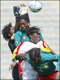 Cameroon players (green shirts) battle with Ghana's Black Queens