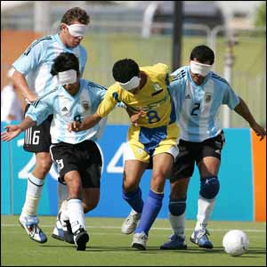 Brazil's Severino Silva (centre) gets tackled in the 5-a-side B1 gold medal match