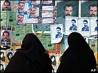 Iranian women read campaign posters