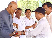 DN Sahay, governor of Tripura receives token weapon from Mantu Koloi, leader of outlawed National Liberation Front of Tripura at a surrender ceremony (pic: Bapi  Roychoudhury)