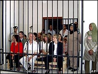 The Bulgarian and Palestinian health workers sit in a cage in the court in a 2003 photo 