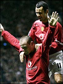 Wayne Rooney celebrates scoring with Ryan Giggs
