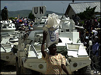 Gonaives people receive aid under UN guard