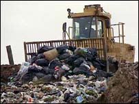 Bulldozer on landfill site