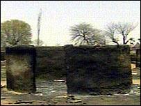 Burnt hut in deserted village