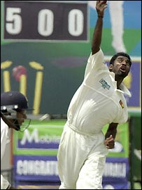 Muralitharan bowls in front of a wicket counter