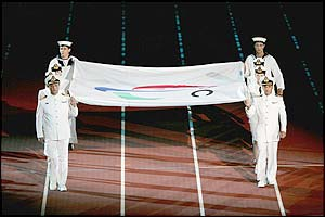 The Paralympic Flag is carried from the stadium