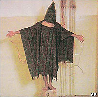 A hooded and wired Iraqi prisoner is seen at the Abu Ghraib prison near Baghdad, Iraq in this undated photo. (AP Photo/Courtesy of The New Yorker)