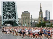 Great North Run: runners cross the Tyne Bridge
