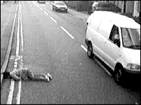 Woman lying helpless in road in south-east London