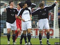Dundee celebrate a goal at Dens Park