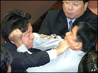 Ruling Democratic Progressive Party lawmaker Lai Ching-teh, left, exchanges punches with independent lawmaker Chu Hsing-yu, May 7, 2004