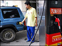 A worker fills gasoline at a gas station