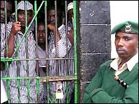 A warden guards prisoners in a crowded Meru prison cell in Kenya