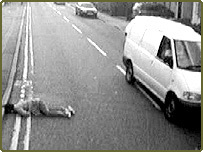 Injured woman lying in road