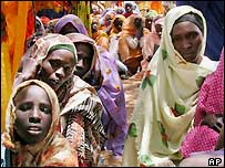 Sudanese villagers wait for food distribution in the Sudanese Liberation Army (SLA) controlled village of Deesa, north of El-Fasher, Darfur