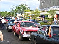 Cars line up to buy petrol
