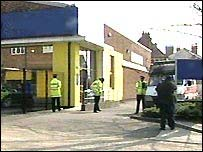 Police guard the storage unit in West London where ammonium nitrate was found