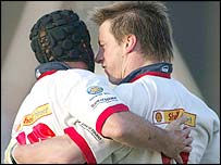 David Humphreys congratulates Ulster try-scorer Tyrone Howe