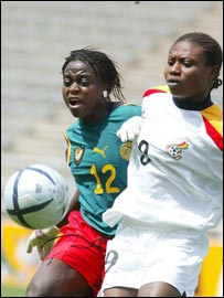 Cameroon's Josephine Bella (left) contests possession with her Ghanaian opponent