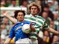Stan Varga keeps a close eye on Michael Mols